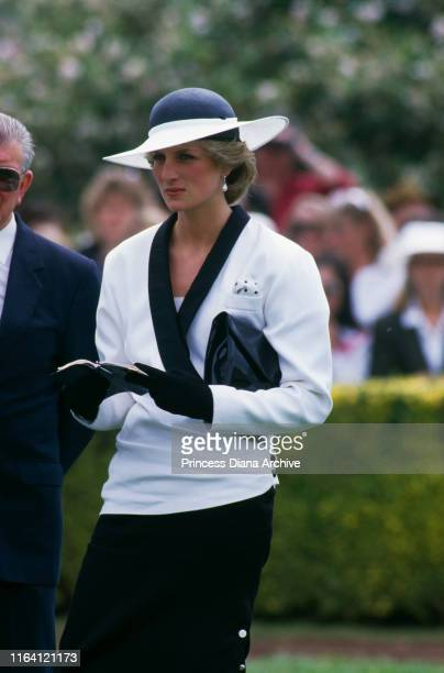 Princess Diana at Flemington race course in Melbourne, Australia, 5th November 1985. She is wearing a suit by Bruce Oldfield and a hat by Frederick...