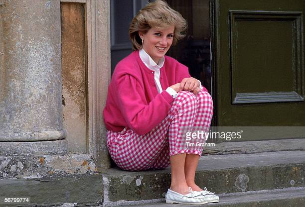 Princess Diana at home, sitting on the steps of Highgrove House.