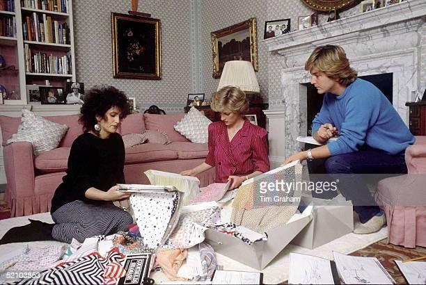 Princess Diana At Kensington Palace With Fashion Designers David And Elizabeth Emanuel Choosing Fabrics For Her Forthcoming Royal Tour