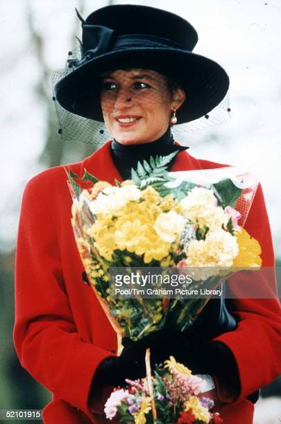 Princess Diana At Sandringham On Christmas Day The Princess Is Wearing A Red Coat And A Broadbrimmed Black Hat She Is Carrying A Bouquet Of Flowers
