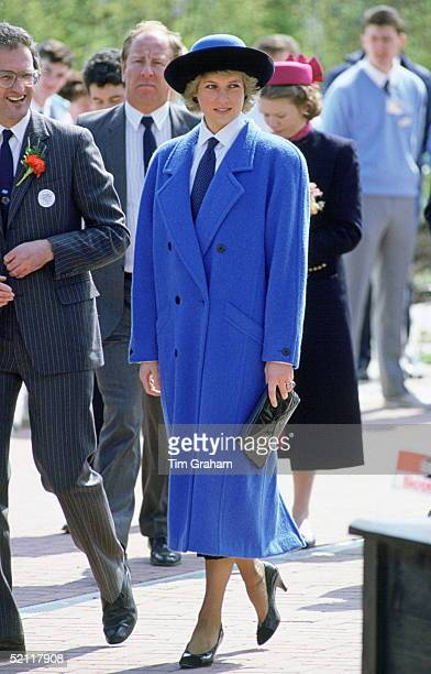 Princess Diana At The Glasgow Garden Festival She Is Wearing A Shirt And Tie Underneath A Blue Coat