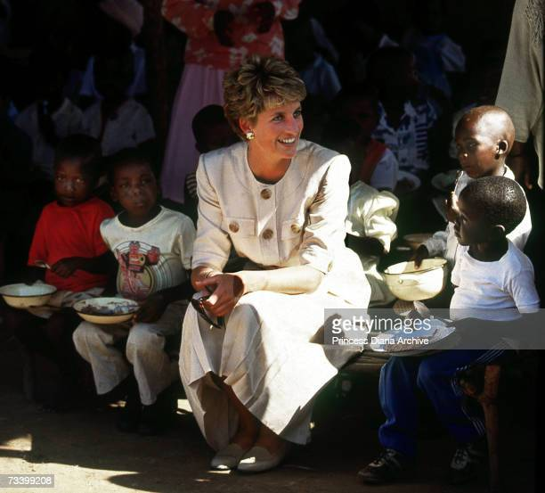 Princess Diana at the Nemazura feeding centre a Red Cross project for refugees in Zimbabwe July 1993 She is wearing a safari suit by Catherine Walker