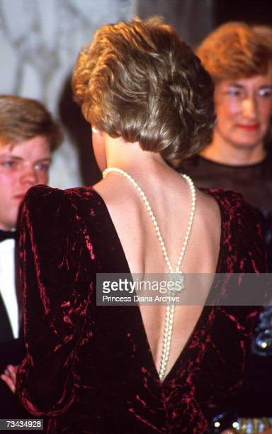 Princess Diana at the premiere of 'Back To The Future' London December 1985She is wearing a plum crushedvelvet evening gown with a low backline and...