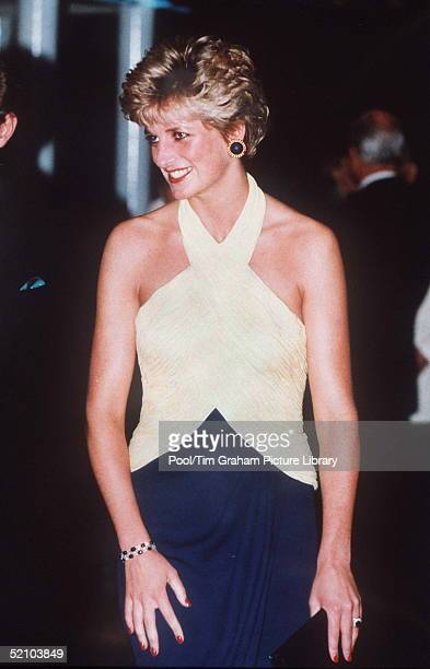 "Princess Diana At The Premiere Of ""far And Away"" At The Leicester Square Empire Cinema. In A Yellow And Navy Blue Halter Neck Evening Dress Designed..."