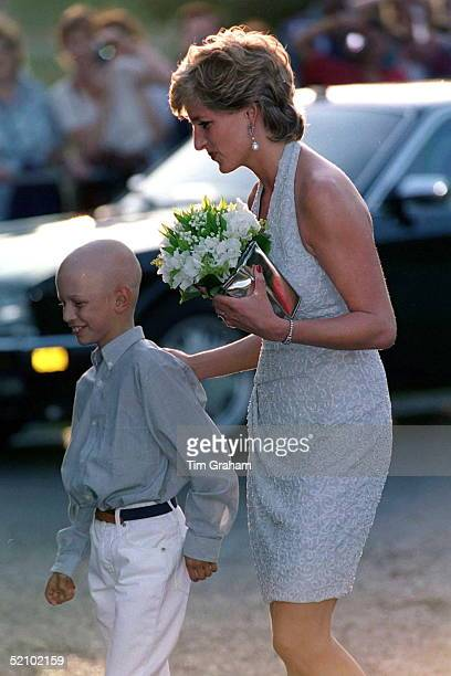Princess Diana At The Serpentine Gallery In Hyde Park Receives Bouquet From Leukaemia Sufferer Thomas Waleycohen