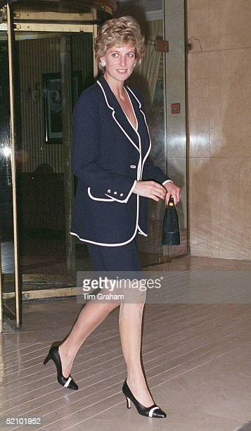 Princess Diana Attending A Charity Lunch At The Hilton Hotel London The Princess Is Wearing A Blue Suit Trimmed In White With Twotone Shoes