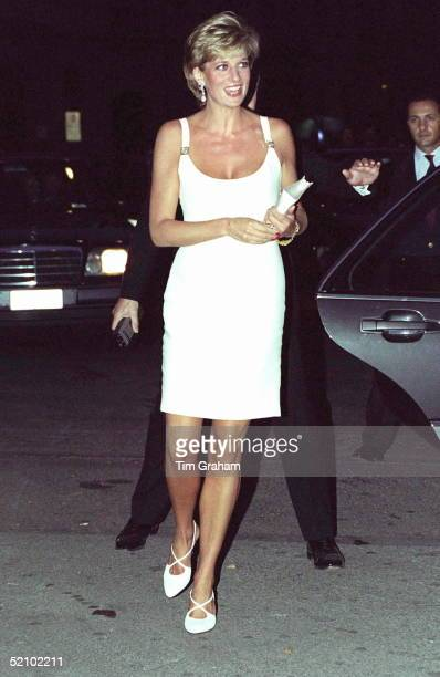 Princess Diana Attending A Concert In Italy In Aid Of Bosnian Children The Princess Is Wearing A Short White Dress And White Shoes