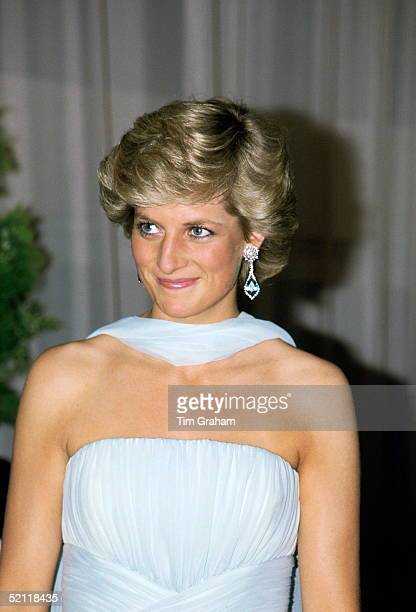 Princess Diana Attending The Film Festival In Cannes Wearing A Pale Blue Chiffon Dress And Wrap Designed By Fashion Designer Catherine Walker