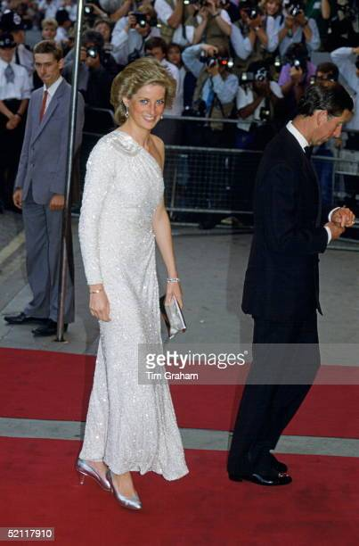 Princess Diana Attending The Film Premiere Of The James Bond Film 'a Licence To Kill.' She is wearing a white, crystal-beaded silk chiffon assymetric...