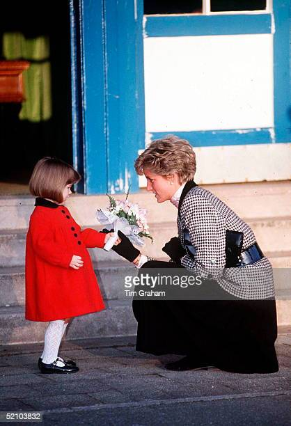 Princess Diana Being Presented With Flowers By The Daughter Of A British Serviceman.the Princess Was Visiting The Families Of British Troops Serving...