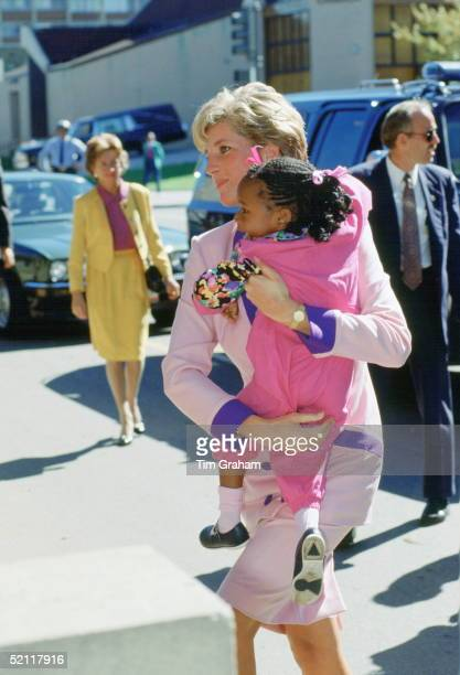 Princess Diana Carrying A Young Girl As She Visits 'grandma's House' Which Looks After Aids Sufferers In Washington