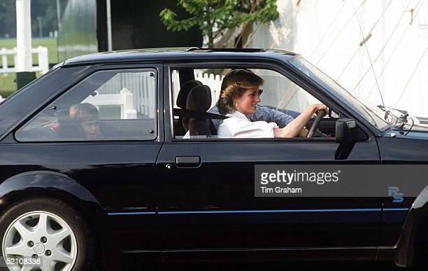 Princess Diana Driving Her Ford Escort With Prince William Sitting In A Special Car Seat Behind