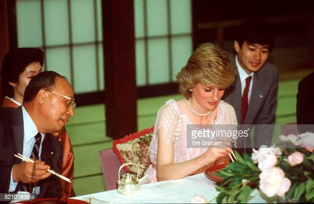Princess Diana Eating With Chopstick During An Official Visit To Japan Her Dress Is Designed By Fashion Designer Zandra Rhodes