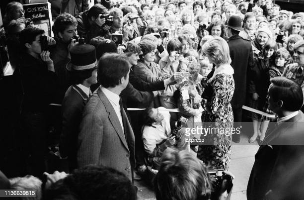 Princess Diana greeting the crowds outside the Hotel Café Royal where she is attending an event London UK 26th October 1983