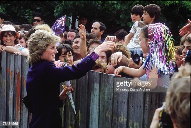 Princess Diana greets local people during a visit to a multicultural children's centre in Melbourne Australia November 1985