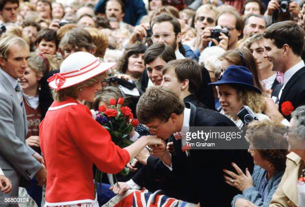 Princess Diana having her hand gallantly kissed by a student during a walkabout in Melbourne Australia