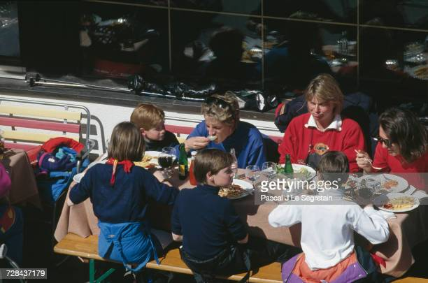 Princess Diana having lunch with her sons Prince Harry and Prince William during a holiday in the Austrian ski resort of Lech 25th March 1994 With...