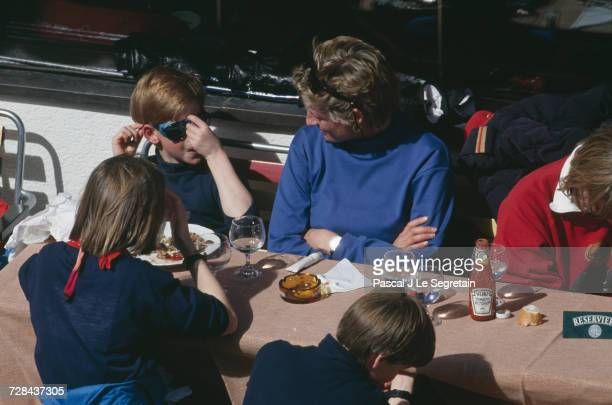 Princess Diana having lunch with her sons Prince Harry and Prince William during a holiday in the Austrian ski resort of Lech 25th March 1994