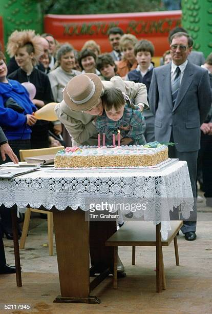 Princess Diana Helping A Girl To Blow Out The Candles On A Birthday Cake To Celebrate The 4th Birthay Of Dr Barnado's Child Care Unit In Belfast...