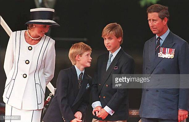 Princess Diana her sons Harry and William and Prince Charles watch the parade march past as part of the commemorations of VJ Day 19 August in London...