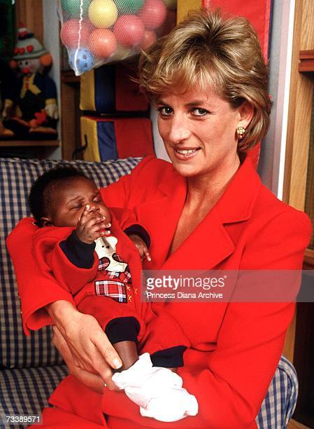 Princess Diana holding eight week old baby Tamara at the London Lighthouse a centre for people affected by HIV and AIDS in London October 1996