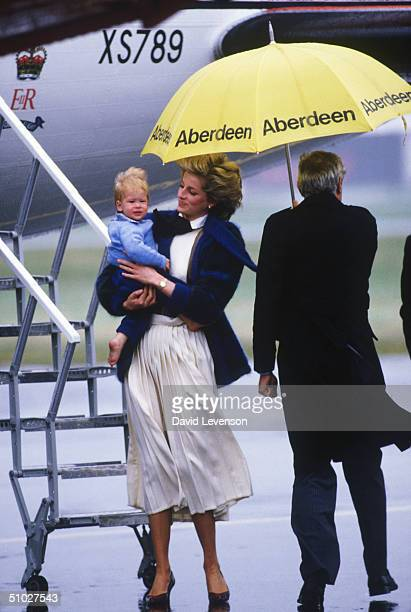 Princess Diana holding her son Prince Harry as they leave Aberdeen Airport on September 23 1985 in Aberdeen Scotland on a Royal Flight at the end of...