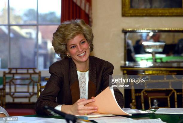 Princess Diana Holding Papers Sitting At Her Dining Room Table At Home In Kensington Palace, London And Taking Part In A Planning Meeting To...
