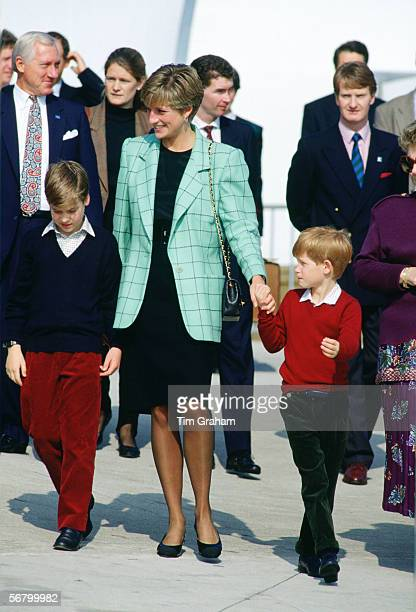 Princess Diana holds hands with Prince William and Prince Harry at Niagra Falls during a trip to Canada