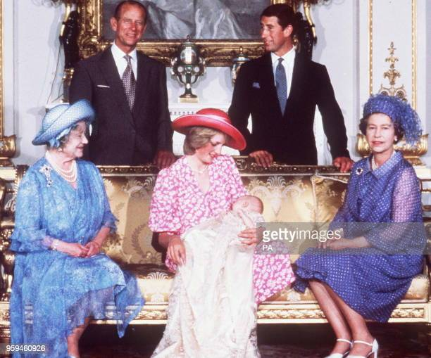 Princess Diana holds Prince Williams 04 August 1982 after his Christening flanked by the Queen and the Queen mother as Prince Charles and the Duke of...