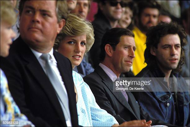 Princess Diana, HRH Prince Charles and Bob Geldof watch from the crowd during the Live Aid concert at Wembley Stadium on 13 July, 1985 in London,...