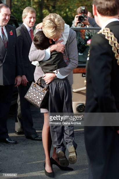 Princess Diana hugging a young boy pupil after opening the Foundation for Conductive Education for the disabled in Birmingham October 1995