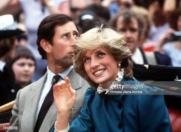 Princess Diana in an opentop carriage with Prince Charles in St Columb Cornwall May 1983 The princess is wearing a green wool suit and cream ruffle...