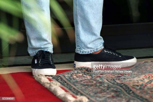 Princess Diana In Angola Wearing Denim Jeans And Trainers