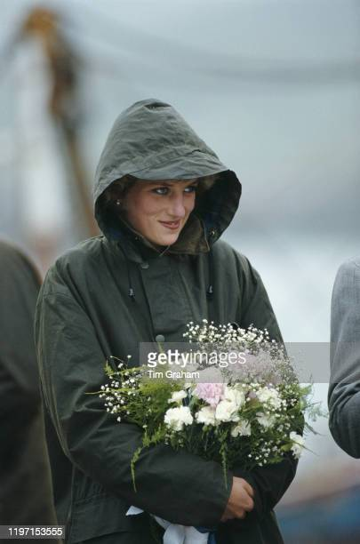 Princess Diana in Ardveenish, in the Western Isles of Scotland, July 1985. She is keeping dry in a green Barbour coat.