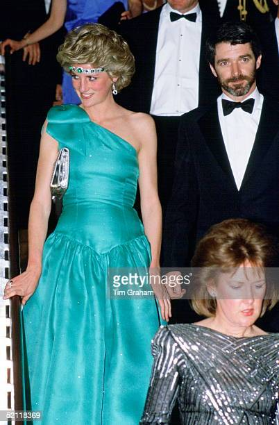Princess Diana In At A Gala Dinner Dance In Melbourne Australia Wearing An Emerald Necklace As A Headband With A Green Satin Evening Dress Designed...
