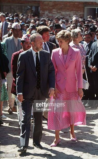 Princess Diana In Nepal Wearing A Pink Skirt With Blue Polka Dots And A Pink Jacket