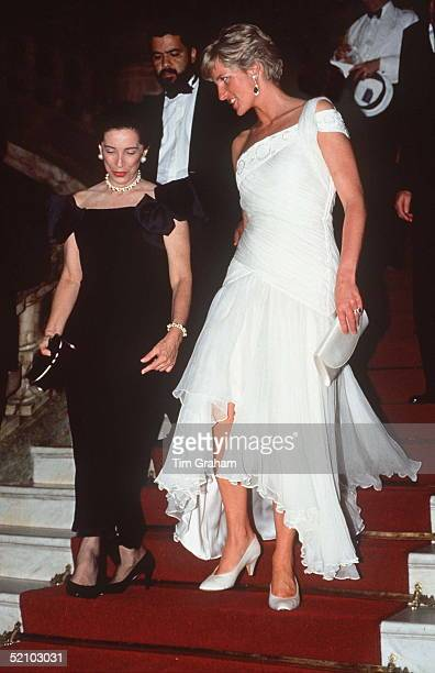Princess Diana In Rio De Janeiro, Brazil Attends A Charity Gala Ballet Performance At The Municipal Theatre. Wearing A White Chiffon Dress Designed...