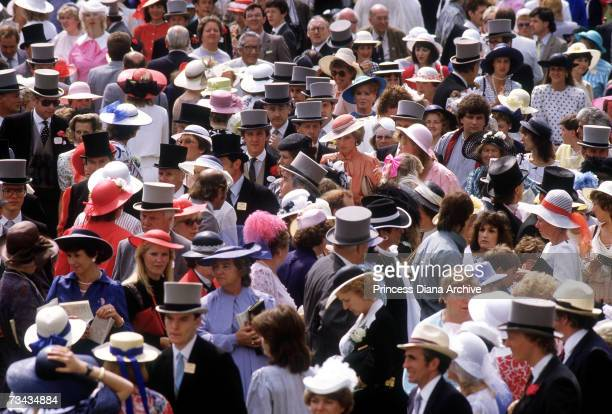 Princess Diana in the crowd in the royal enclosure during race week at Ascot, June 1985. She is wearing a suit by Jan van Velden. Behind her is Sarah...