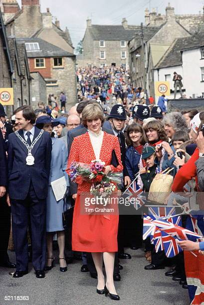 Princess Diana In The Local Town Of Tetbury Is Greeted By A Huge Crowd Of Royal Fans With Union Jack Flagswearing A Suit Designed By Jasper Conran