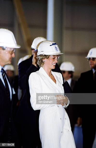 Princess Diana Laughing At Her Husband Wearing A Similiar Builder's Hard Hat To Hers, At An Aluminium Smelting Plant In Australia.