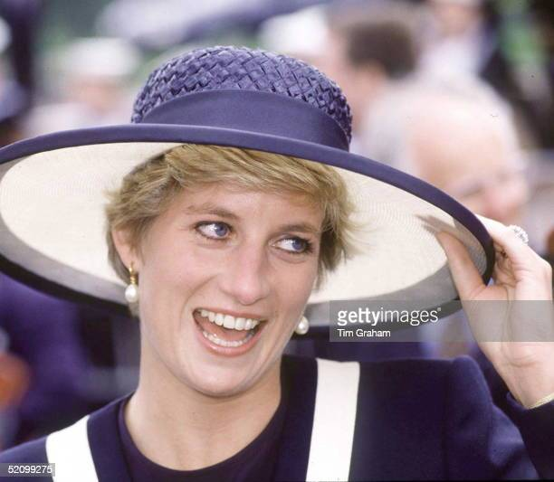 Princess Diana Laughing During Her Visit To Liverpool She Is Holding The Brim Of Her Hat As It Is A Windy Day