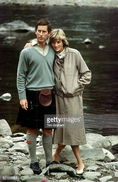 Princess Diana Leaning Into Prince Charles With Her Arm Around His Shoulder As They Pose Together During A Honeymoon Photocall By The River Dee,...
