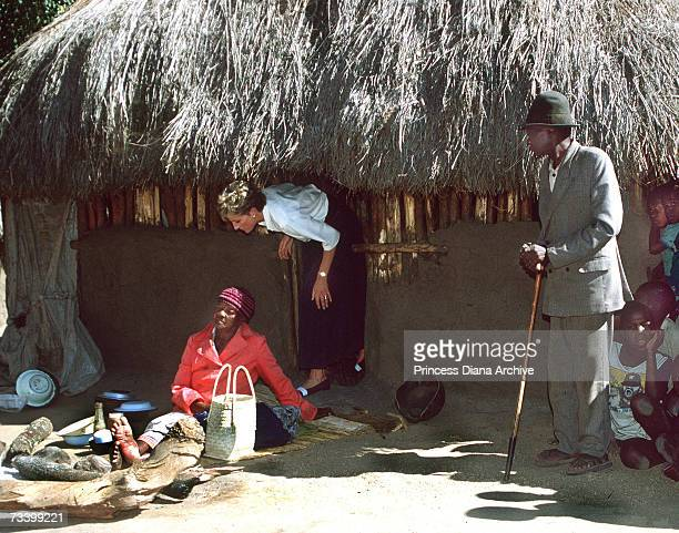 Princess Diana leaving a mud hut at the Tongogora refugee camp where she visited leprosy sufferers during her official visit to Zimbabwe July 1993