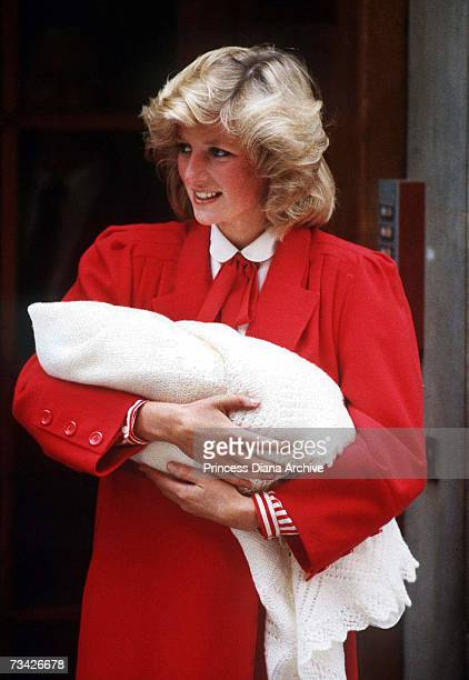 Princess Diana leaving St Mary's Hospital, London with her new-born son Prince Harry, 16th September 1984. She is wearing a red coat by Jan van...