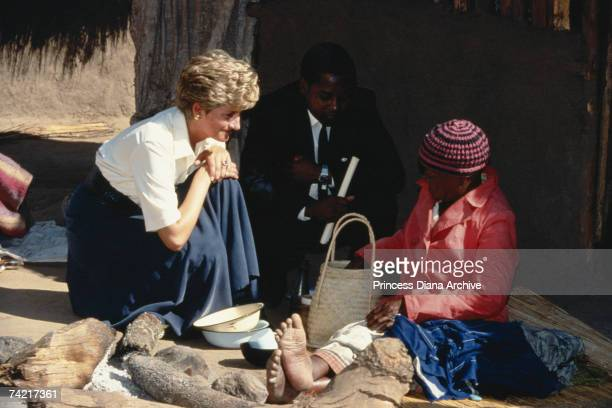 Princess Diana meeting a local woman during a visit to Zimbabwe July 1993