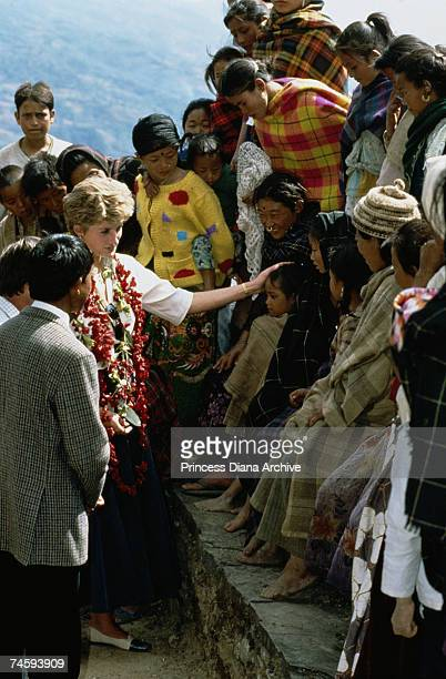 Princess Diana meets local people during a field visit to Red Cross projects in the remote mountain villages of Nepal 3rd March 1993