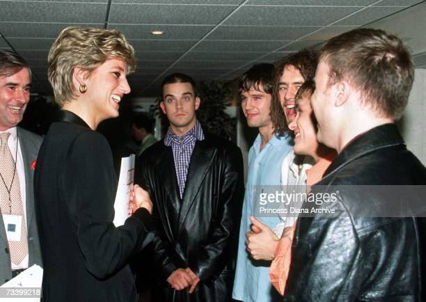 Princess Diana meets pop singer Robbie Williams and other members of boyband Take That at a 'Concert Of Hope' AIDS benefit at Wembley Arena London...