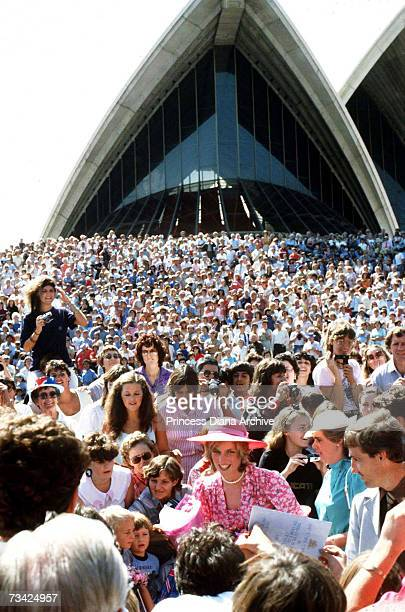 Princess Diana mingles with the public outside Sydney Opera House 28th March 1983 She is wearing a pink dress by Belville Sassoon and a hat by John...