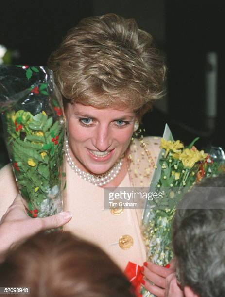 Princess Diana Patron Headway National Head Injuries Association Being Given Flowers By A Member Of The Crowd Before Having Lunch At The Hilton Hotel...