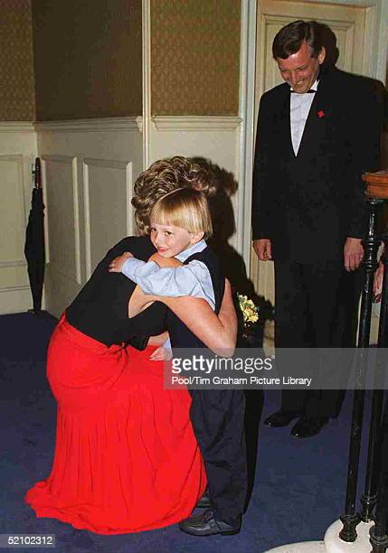 Princess Diana Patron Of British Red Cross Youth At The Red Cross Concert To Commemorate Ve Day At The Royal Albert Hall Hugs 5 Yearold Ben Clark Who...